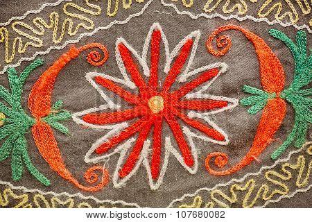 Natural patterns on vintage blanket with symbols