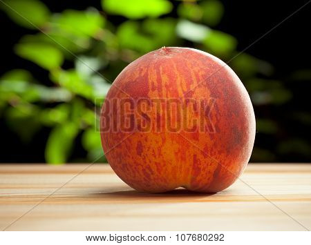 Red fresh peach on the table in the garden poster