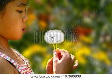 Little Girl Blowing A Dandelion