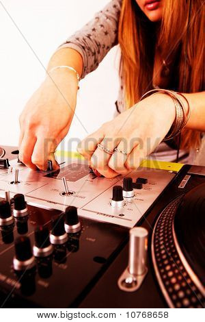 Hands Of Female Dj Playing Vinyl