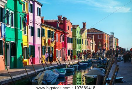 Bright coloured houses on coast of channel in Burano island Venice Italy. Illustration