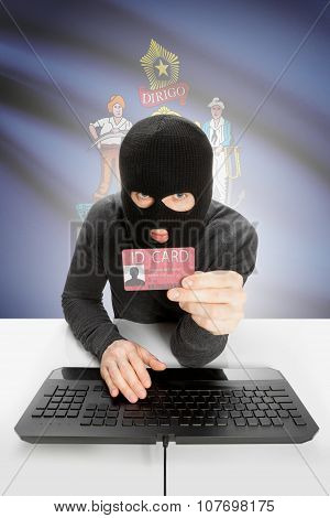 Hacker With Usa States Flag On Background And Id Card In Hand - Maine