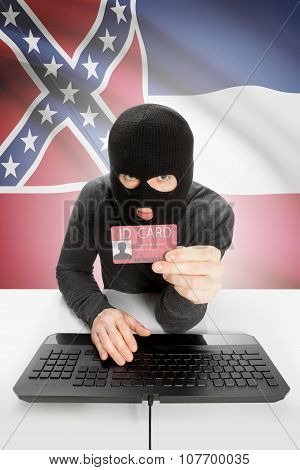 Hacker With Usa States Flag On Background And Id Card In Hand - Mississippi