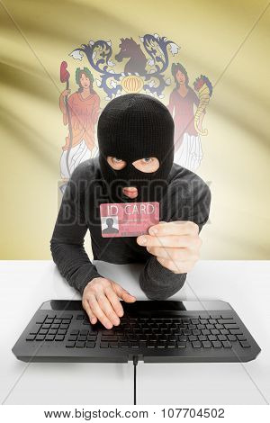 Hacker With Usa States Flag On Background And Id Card In Hand - New Jersey