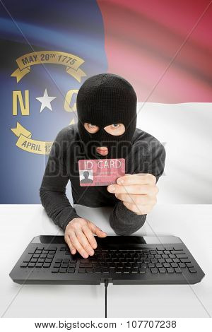 Hacker With Usa States Flag On Background And Id Card In Hand - North Carolina