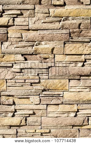 Decorative relief cladding slabs imitating stones on wall closeup poster