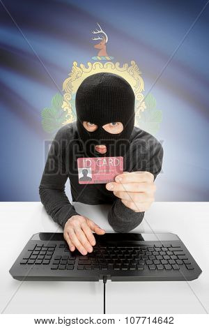 Hacker With Usa States Flag On Background And Id Card In Hand - Vermont