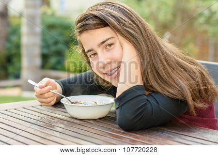 Teenage Girl Enjoying Chicken Soup