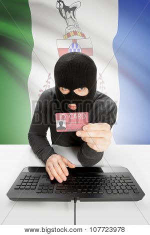 Hacker With Canadian Province Flag On Background Holding Id Card In Hand - Yukon