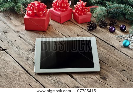 White Tablet Computer With Christmas Gifts