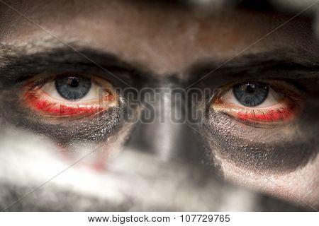 Eyes Of A Man Wearing Skull Makeup