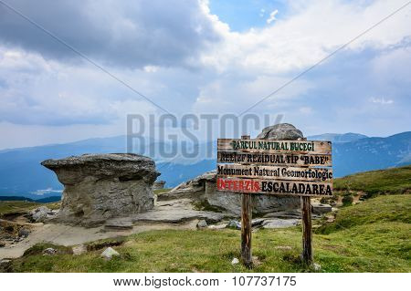 Sign Of Entrance To Babele - Geomorphologic Rocky Structures In Bucegi Mountains, Romania.