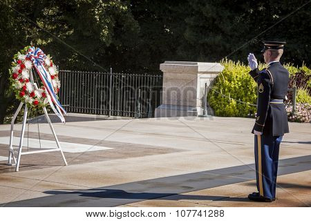 ARLINGTON, VA - SEPT 11, 2015: The relief commander salutes during the changing of the guard ceremony at the Tomb of the Unknown Soldier in Arlington National Cemetery.