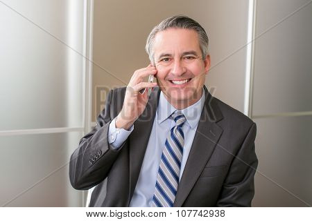Mature happy business man on the phone