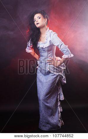 portrait of halloween vampire woman aristocrat with stage makeup