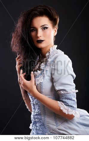 portrait of vampire woman aristocrat with stage makeup