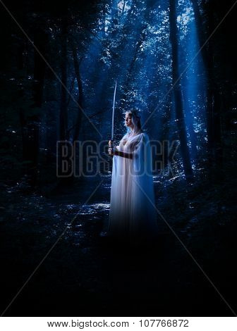 Young elven girl with sword in night forest