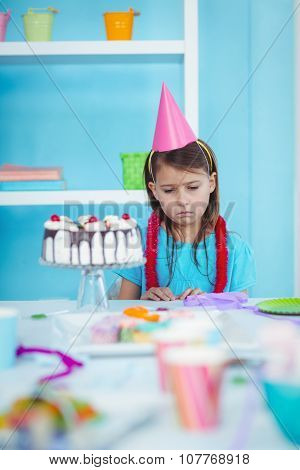 Sad kid alone at her birthday party