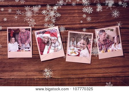 Instant photos on wooden floor against man carving chicken during christmas dinner