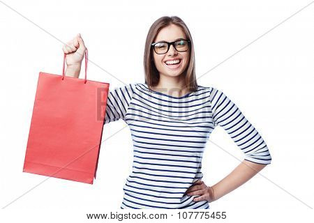 Young shopper in eyeglasses holding red paperbag