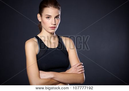 Portrait beautiful young athletic girl on a black background