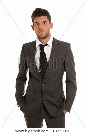 Young Businessman Looking Serious Hands In Pockets Isolated On White Background