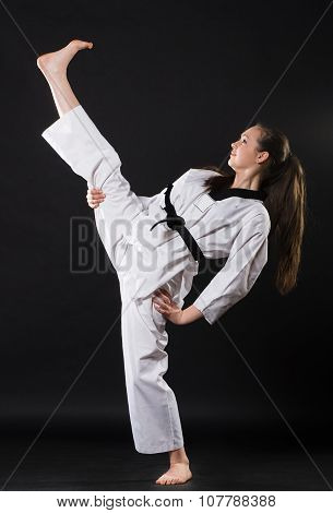 girl in kimono exercising karate kata