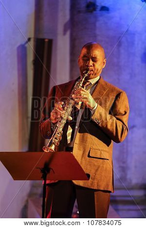 CRACOW POLAND - OCTOBER 29 2015: Branford Marsalis sax playing live music at The Cracow Jazz All Souls' Day Festival in Saint Catherine's Church. Cracow. Poland