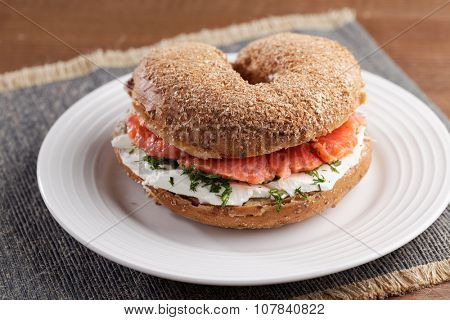 Bagel sandwich with salmon and cream cheese on a plate