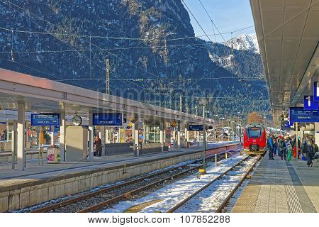 GARMISCH-PARTENKIRCHEN GERMANY - JANUARY 06 2015: View of the Garmisch-Partenkirchen train station on a sunny winter day. Bavaria. Germany