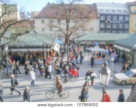 Defocused Background Of People Walking In Central Munich. Intentionally Blurred Post Production
