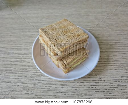 The kaya toasts on the white dish in Singapore