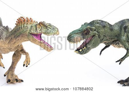 Tyrannosaurus And Allosaurus Toy On A White Background
