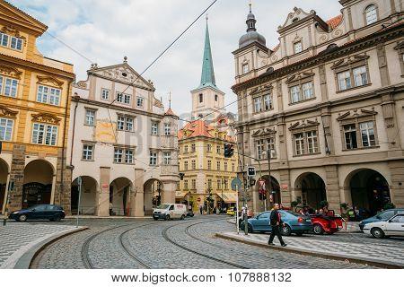 People walking on the street Malostranske namesti in Prague, Cze