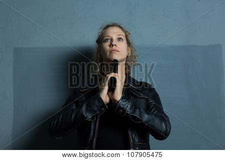 Young despair woman with handgun killing herself poster