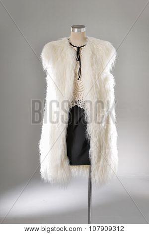 female white fur dress on dummy-light background
