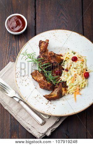 Grilled sliced barbecue pork ribs Salad cole slaw