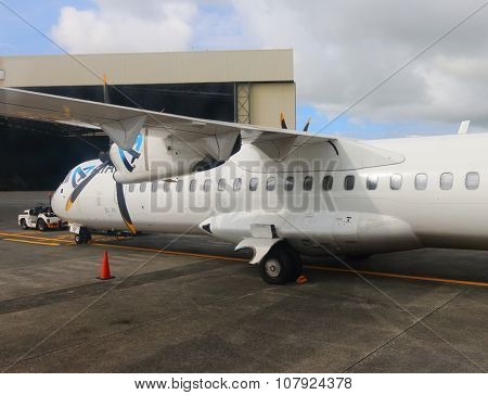 PLAINE MAGNIEN MAURICIUS - NOVEMBER 3, 2015: Maintainance unit preparing Aerospatiale/Alenia ATR 72 Air Austral for flight on SSR International Airport. Turbopropelled aircraft for 64 passengers.