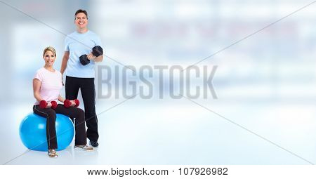 Young healthy fitness couple. Over blue background