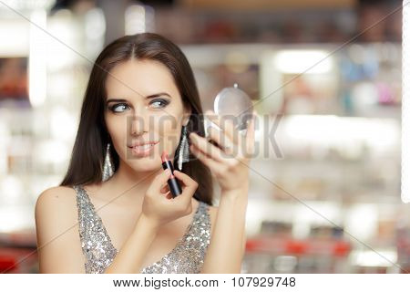 Glamour Woman with Lipstick and Make-up Mirror