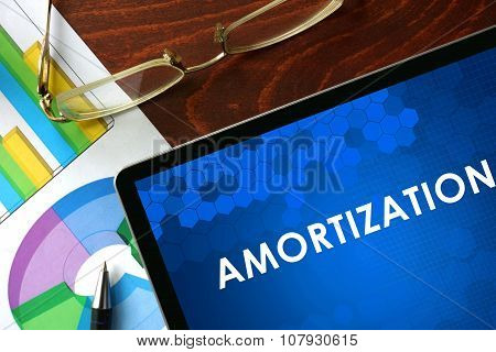 Tablet with amortization on a table.