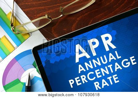 Tablet with annual percentage rate (APR) on a table.