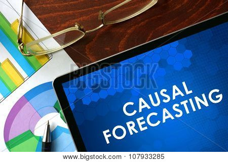 Tablet with causal forecasting on a table.