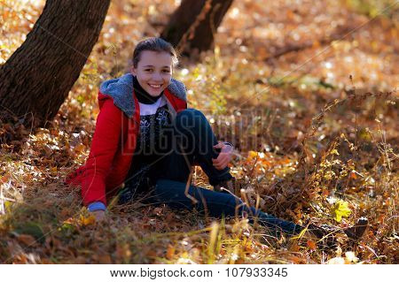 The Cheerful Girl In Park In The Autumn.