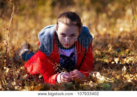Angry Sight Of The Girl In Autumn Park.