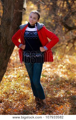 The Playful Girl Walks In Autumn Park.
