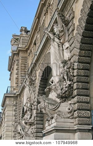PARIS FRANCE - NOVEMBER 27 2009: Fragment of one of facades of the royal Louvre palace. Now Louvre is one of the largest museums in the world poster