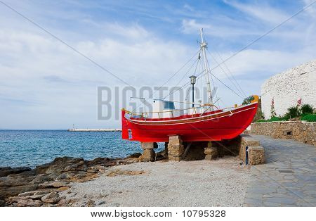 The Famous Red Boat-restaurant On The Island Of Mykonos By The Sea .. Greece.