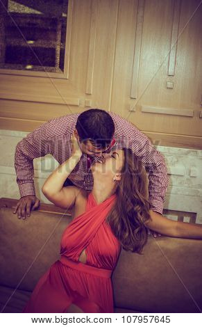 enamored couple posing in a hall