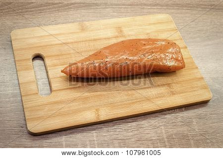 smoked turkey meat on wooden chopping board